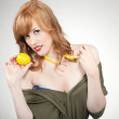 Young happy woman holding a lemon — Stock Photo