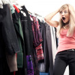 Young happy woman has a plenty of clothes to choose from — 图库照片