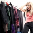 Young happy woman has a plenty of clothes to choose from — ストック写真