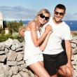 Smiling young couple with sunglasses — Stock Photo