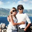 Stockfoto: Smiling young couple with sunglasses