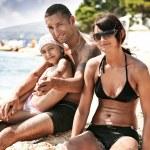 Happy family on a ocean coast — Stock Photo