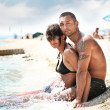 Attractive couple relaxing on the beach — Stock Photo