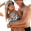 Foto Stock: Young attractive couple on a beach
