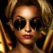Young attractive blonde wearing stylish sunglasses — Foto de Stock