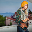 Fashion style photo of a young lady on summer evening — Stock Photo