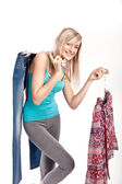 Young blonde choosing what to put on — Stock Photo