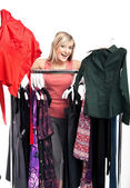 Young happy woman has a plenty of clothes to choose from — Stockfoto