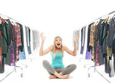 Happy blonde beauty in a wardrobe — Stock Photo