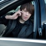 Elegant man in a car, calling — Stock Photo