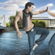 Two karate fighters kicking on the riverside — Stock Photo