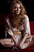 Young lady wearing white dress — Stock Photo