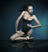 Vogue style photo of a sexy brunette — Стоковое фото