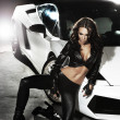 Sexy lady in front of a sport car - Stock Photo