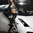 Sexy lady in front of a sport car — Stock Photo #4578829
