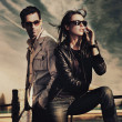 Attractive young couple wearing sunglasses — Stock Photo #4578868