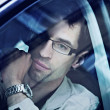 Handsome man sitting in a car — Stockfoto #4578942
