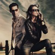 图库照片: Attractive young couple wearing sunglasses