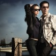 Attractive young couple wearing sunglasses — Stock Photo