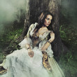 Young lady in a mysterious forest - Stockfoto