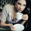 Foto Stock: Calm lady drinking coffee