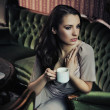 Portrait of a beautiful lady drinking afternoon coffee — Foto de Stock