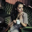 Portrait of a beautiful lady drinking afternoon coffee - ストック写真