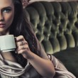 Foto Stock: Portrait of a beautiful lady drinking afternoon coffee
