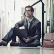 Стоковое фото: Young businessman resting