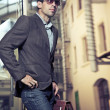Стоковое фото: Confident young businessman holding a briefcase