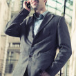 Cheerful businessman chatting over cellphone — Stockfoto