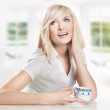 Cheerful young woman drinking coffee — Foto Stock