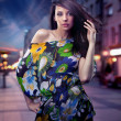 Cute brunette posing on a city street — Stock Photo