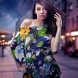 Cute brunette posing on a city street - Stock Photo