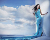 Stunning female beauty wearing blue dress — Stock Photo