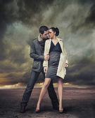 Handsome young couple posing — Stock Photo
