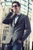 Cheerful businessman chatting over cellphone — Stock Photo