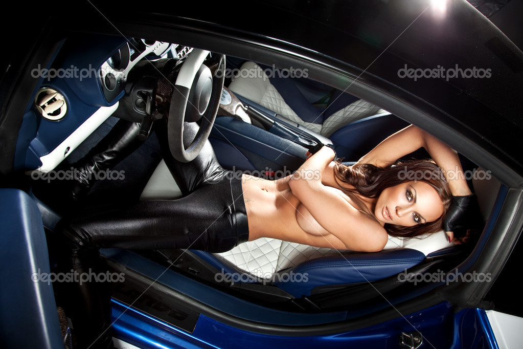Sexy woman sitting in a sport car  — Stock Photo #4578834