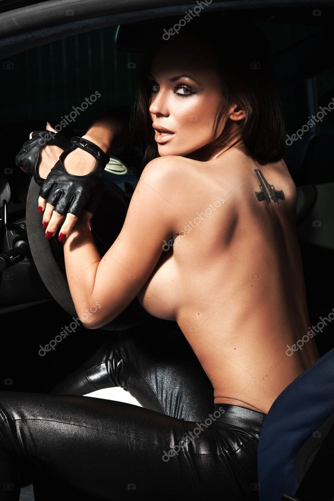 Sexy woman sitting in a sport car  — Stock Photo #4578837