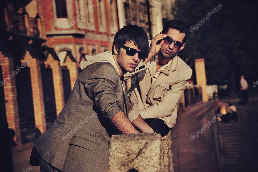 Two handsome friends posing on a city promenade  — Stock Photo #4578958