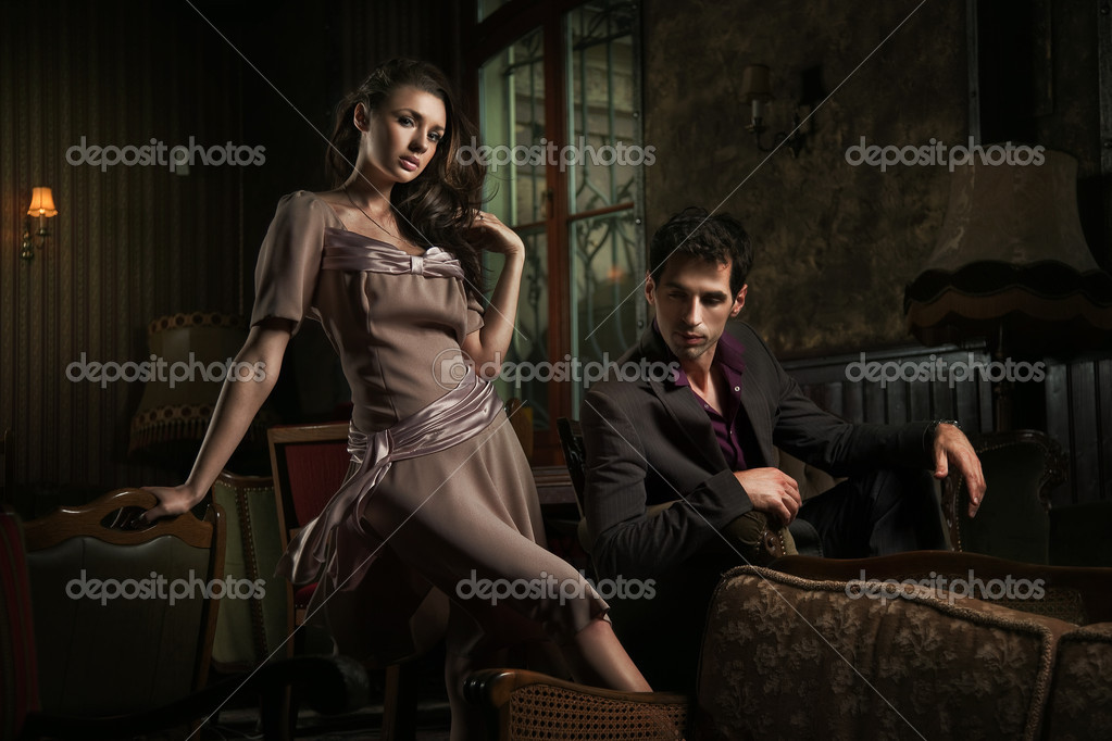 Handsome couple sitting on sofa  — Photo #4579055