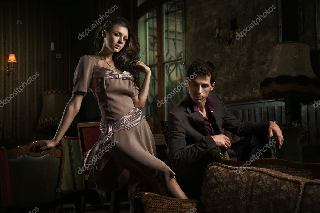 Handsome couple sitting on sofa  — Stockfoto #4579055