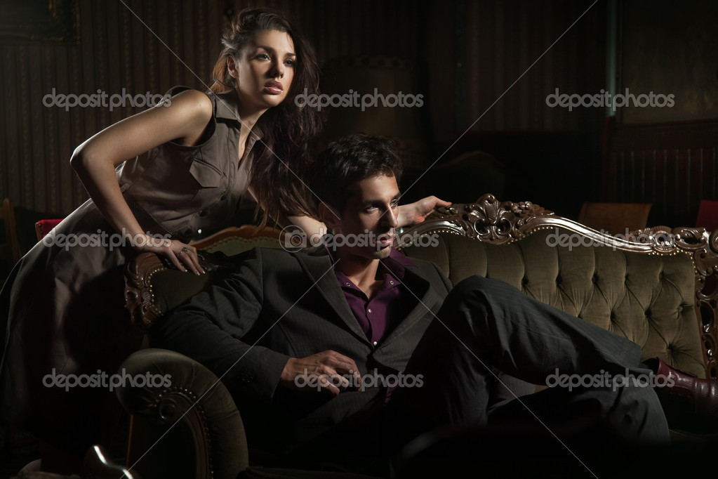 Handsome couple sitting on sofa   Stock Photo #4579067