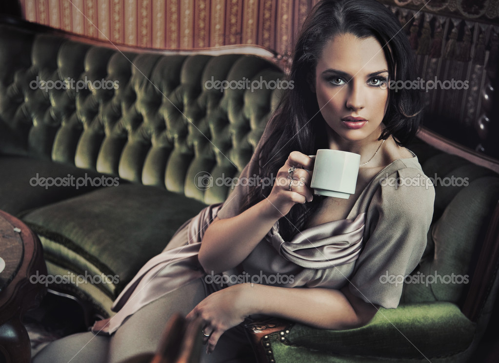 Portrait of a beautiful lady drinking afternoon coffee   Foto Stock #4579087