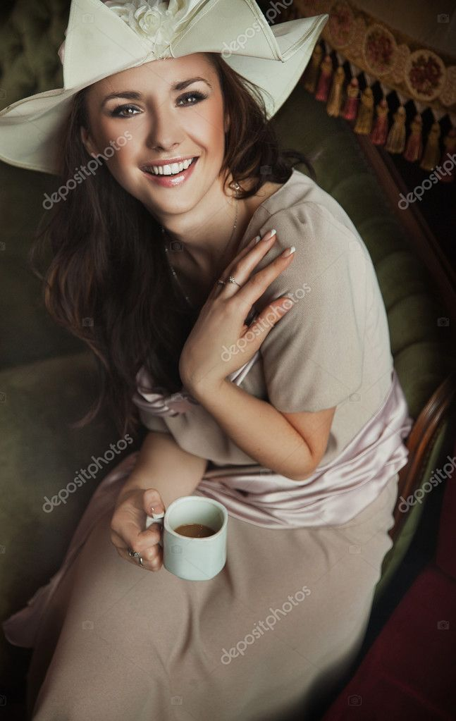 Stylish woman drinking coffee   Stock Photo #4579093