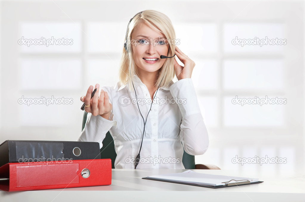 Young female call centre employee   Stock Photo #4579136