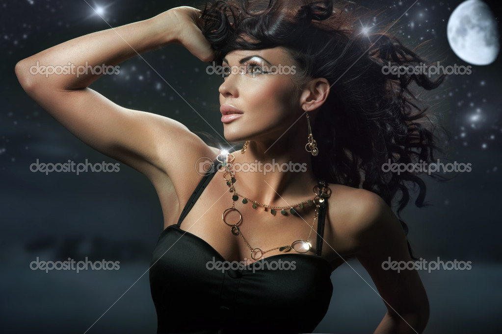 Fashionable brunette over starry night background   Stock Photo #4579263