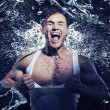 Stock Photo: Muscular man having shower