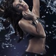 Foto Stock: Young beauty dancing with water splash