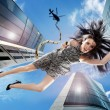 Young brunette falling down the sky - Stock Photo